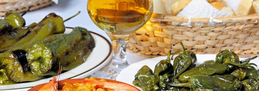 Tapas, Padron peppers, Deep fried pointed peppers, seafood and pork paella, Costa del Sol, Malaga Province, Andalucia, Spain, Western Europe