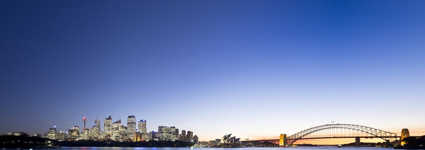 Panoramic view of Sydney Harbour at night