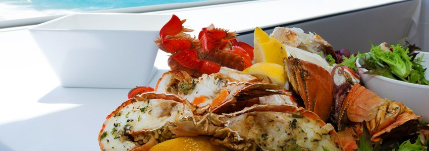 Mixed seafood plate by a tropical beach
