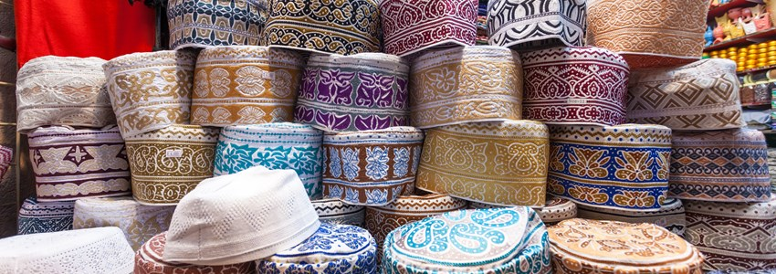 Traditional omani kuma hats for sale at the souq in Muscat