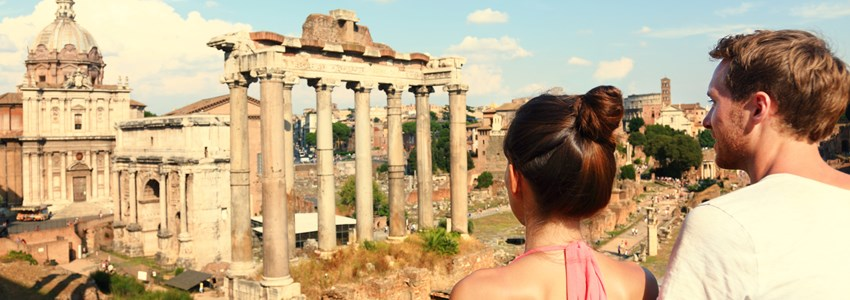 Rome tourists looking at Roman Forum landmark in Rome