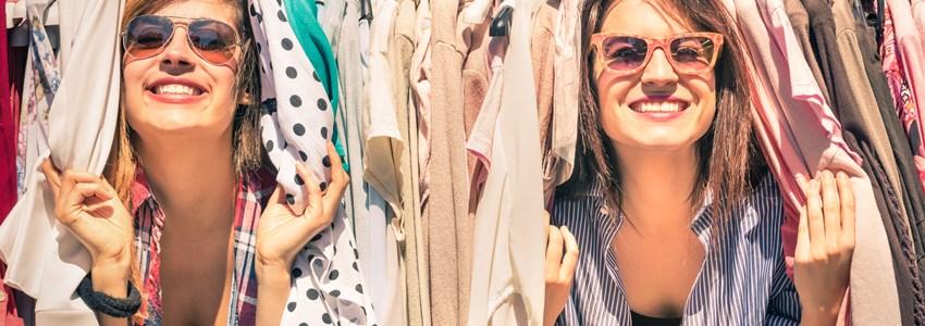 Two women between a clothes rack - Atlanta, Georgia