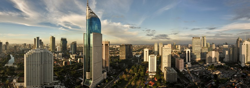 Panoramic cityscape of Indonesia capital city Jakarta at sunset. A r