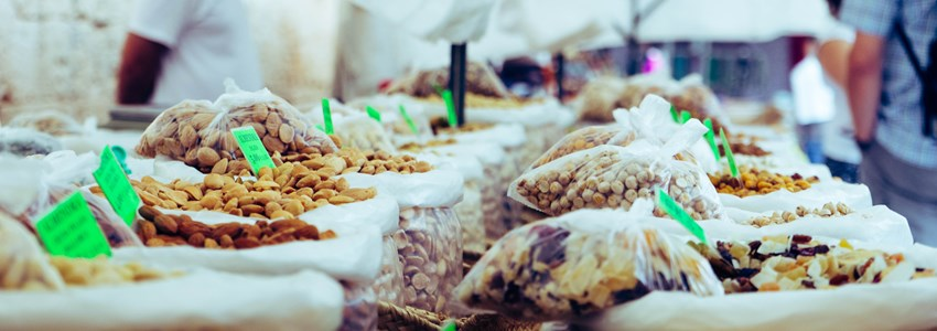 Market stall with various dried fruits and nuts