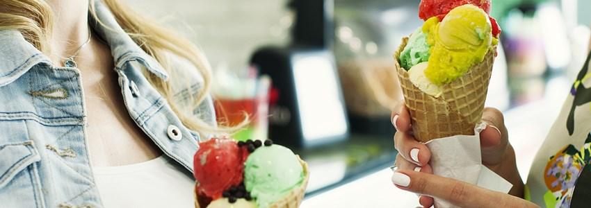 Beautiful girl eating an italian ice cream, selective focus