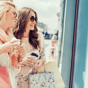 oung attractive girls with shopping bags in the city. / Ivanko80/Shutterstock.com