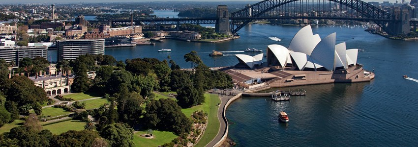 Aerial view of Sydney Harbour featuring the Royal Botanic Gardens, Sydney Opera House and Sydney Harbour Bridge