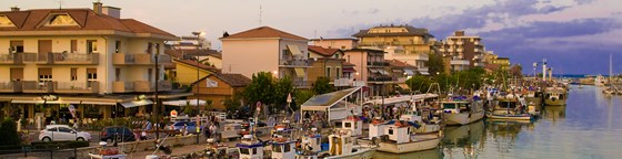 Fishing Boats docked in Igea Marina Bellaria in Rimini at sunset.