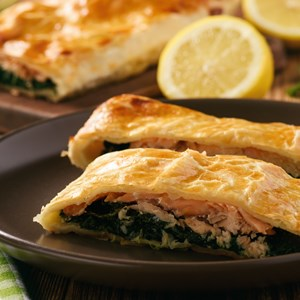 Salmon trout and spinach baked in puff pastry. / Cesarz/Shutterstock.com