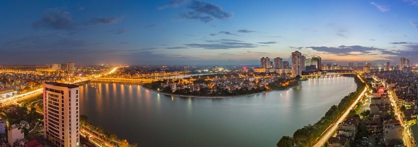 Aerial view of Hanoi skyline cityscape at twilight period. Linh Dam lake, south of Hanoi capital