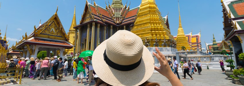 ourist in Wat Phra Kaew in Bangkok, Thailand.