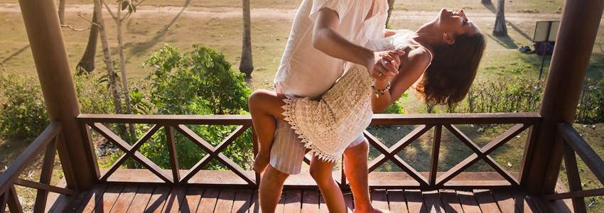 couple resting at Balinese hotel, dancing on the balcony