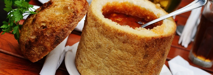 Traditional Romanian beans soup in bread, with spoon, from Transylvania region.