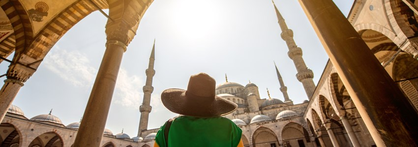 Young woman traveler looking on amazing Blue Mosque in Istanbul, Turkey