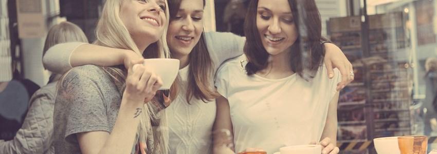 Happy women enjoying a coffee.