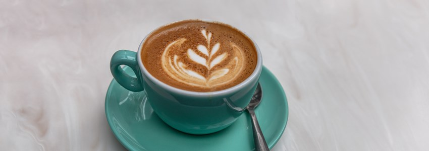 Cappucino latte art coffee cup banner background for cafe.