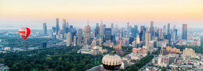 Hot air balloons flying over Melbourne skyline