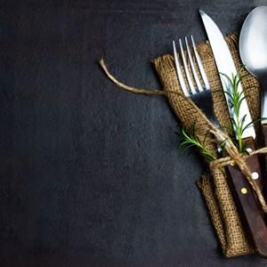 Rustic vintage set of cutlery knife, spoon, fork. / Larisa Blinova/Shutterstock.com