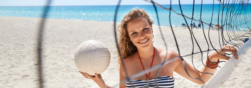 Woman playing voleyball on beach