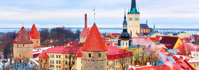 Cityscape with St Olaf Church and defensive towers at the Old town of Tallinn, Estonia in winter.