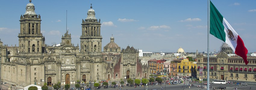 the zocalo in mexico city, with the cathedral and giant flag