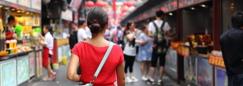 Asian girl on Wangfujing food street during Asia summer vacation