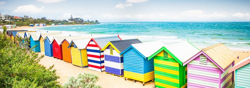 Beautiful Bathing houses on white sandy beach at Brighton beach in Melbourne, Australia.