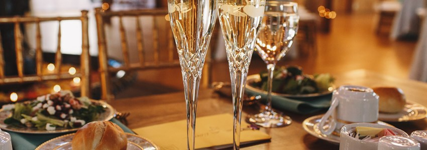 Crystal flutes champagne on table
