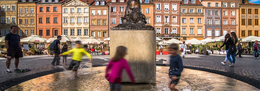 kids playing in front of a statue