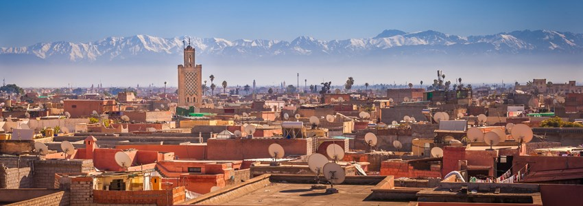 Panoramic view of Marrakesh and the snow capped Atlas mountains, Morocco