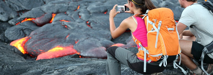 Hawaii lava tourist. Tourists taking photo of flowing lava from Kilauea volcano around Hawaii volcanoes national park, USA